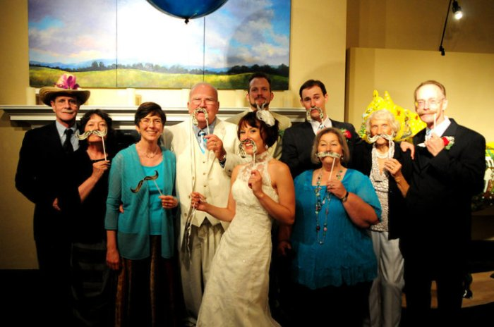 My immediate family and the Professor's immediate family at our wedding. (Yes, there were fake mustaches. Yes, my dad grew an awesome handlebar mustache for the occassion. Yes, my family is an incredibly good sport to humor me and my love of mustaches!)