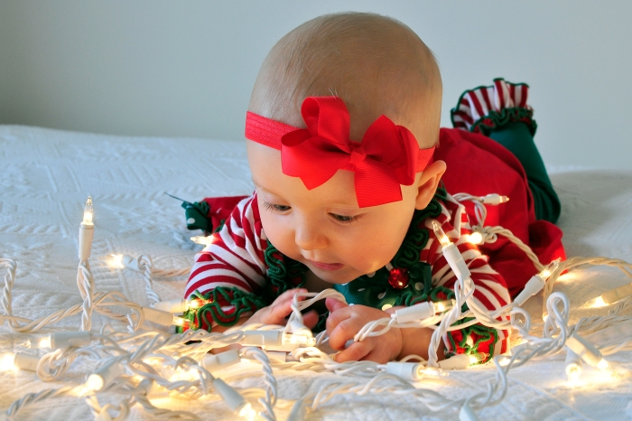 "Merry Christmas! One of Sabine's 5 month photos shot by Mama in her ""studio."" (Studio is our bedroom!)"