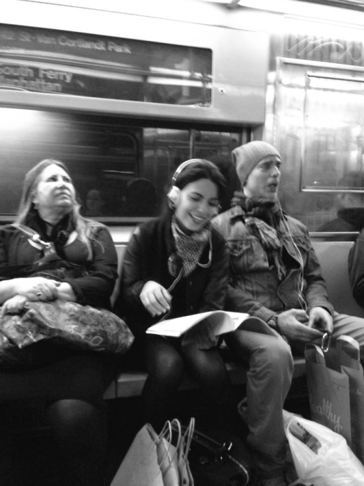 And tonight on the Bronx bound 1 train we have crazy guy in the blue hat singing religious songs in a loud, breathy voice. Meanwhile those around look either uncomfortable or laugh (or take photos).
