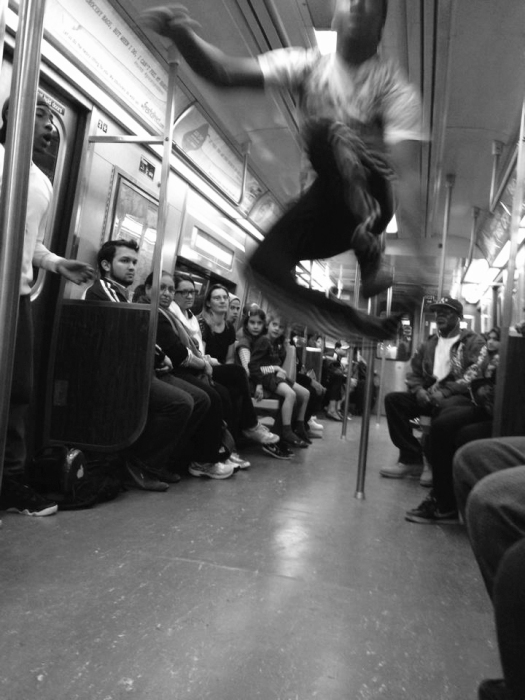 """""""Ladies, you are gonna see black men jumping (yeah) black men flipping (yeah) black men strippin... NAW"""" (Actually on the 2 Train.)"""
