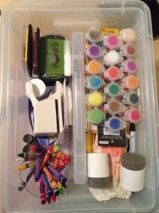The top part of the tub has small stuff, crayons, paints, punches, stamps, etc.