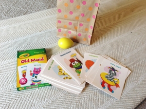 "This was a steal from the Target $1 bin - bright colored cards with fun creatures on them. I know she will have a great time sorting through them and I expect to get mileage out of that box, too! Also in the bag is an ""old toy"" egg shaker - because Daddy will LOVE to listen to this in the car!"